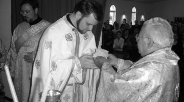 "The Parakatathiki (""Charge""), when the Eucharist is placed in the hands of a newly-ordained priest by the bishop, and he is charged by him to guard it until the Second Coming of Christ.  This picture is from my own ordination."
