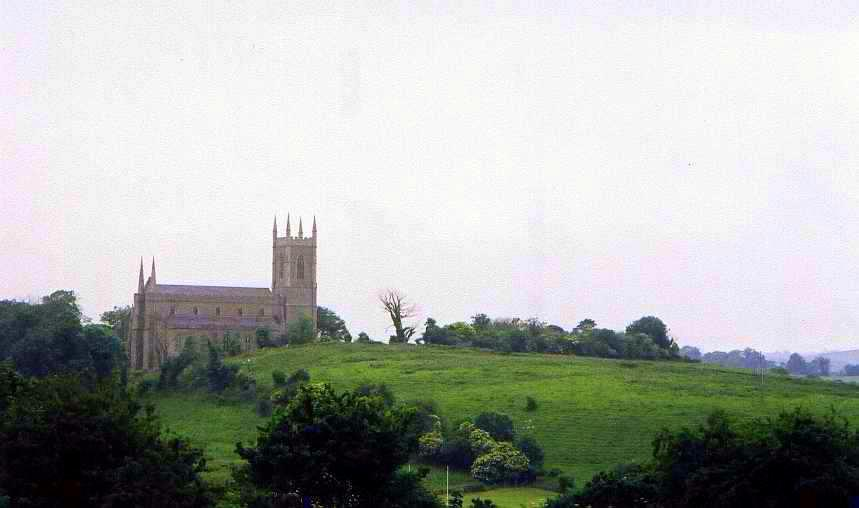 The cathedral in Downpatrick, Northern Ireland. St. Patrick is buried deep within the hill on which it rests, along with Ss. Columba of Iona and Brigid of Kildaire.