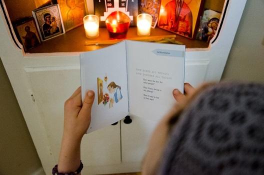 Open book in child's hands