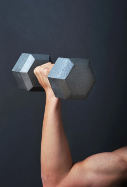 Strong arm lifting dumbbell.