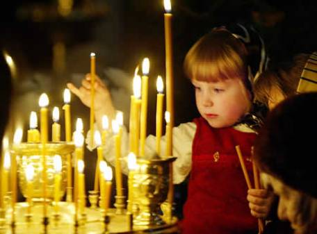 a-child-lights-a-candle-in-a-church-in-moscow-5324
