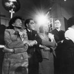 Archbishop Iakovos with arms locked together with Coretta Scott King (MLK's widow) and Pres. G.W. Bush at an MLK Day celebration
