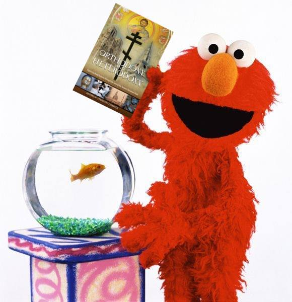 Elmo should know better than to keep fish in a bowl without a power filter, but he still has impeccable taste in reading,